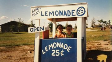 boy and girl in a lemonade stand on the beach
