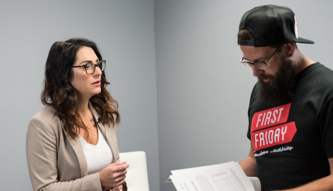 business can be better co-hosts lane and kelli-rae working together on a video shoot looking at notes