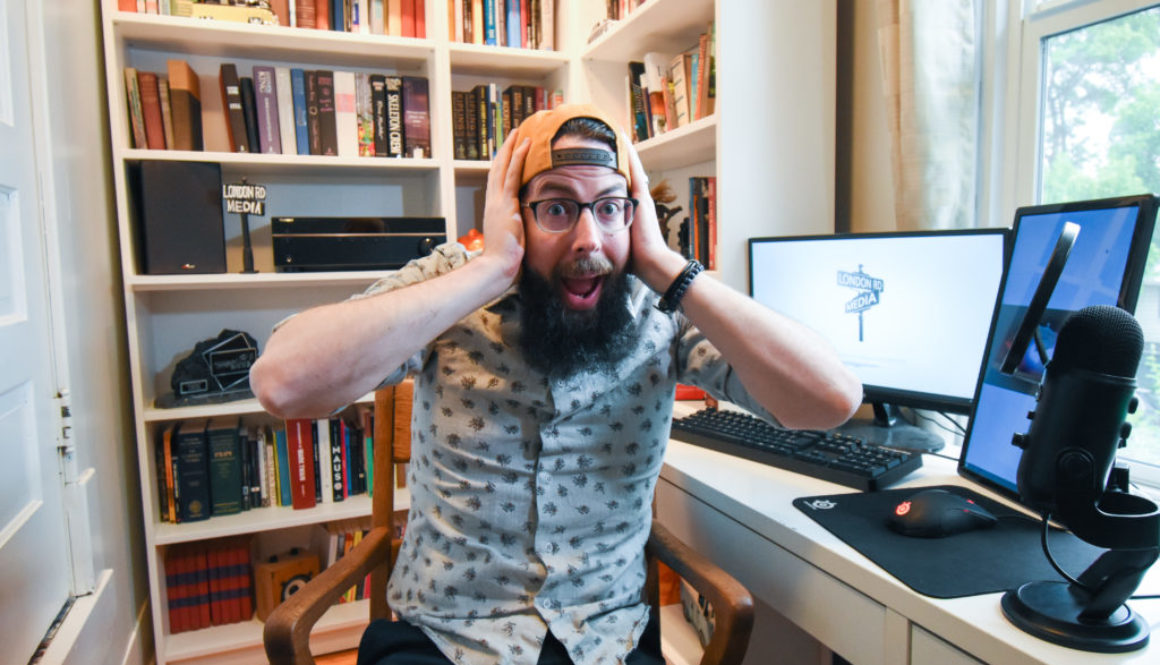 business can be better podcast cohost lane holding his head sitting at a desk