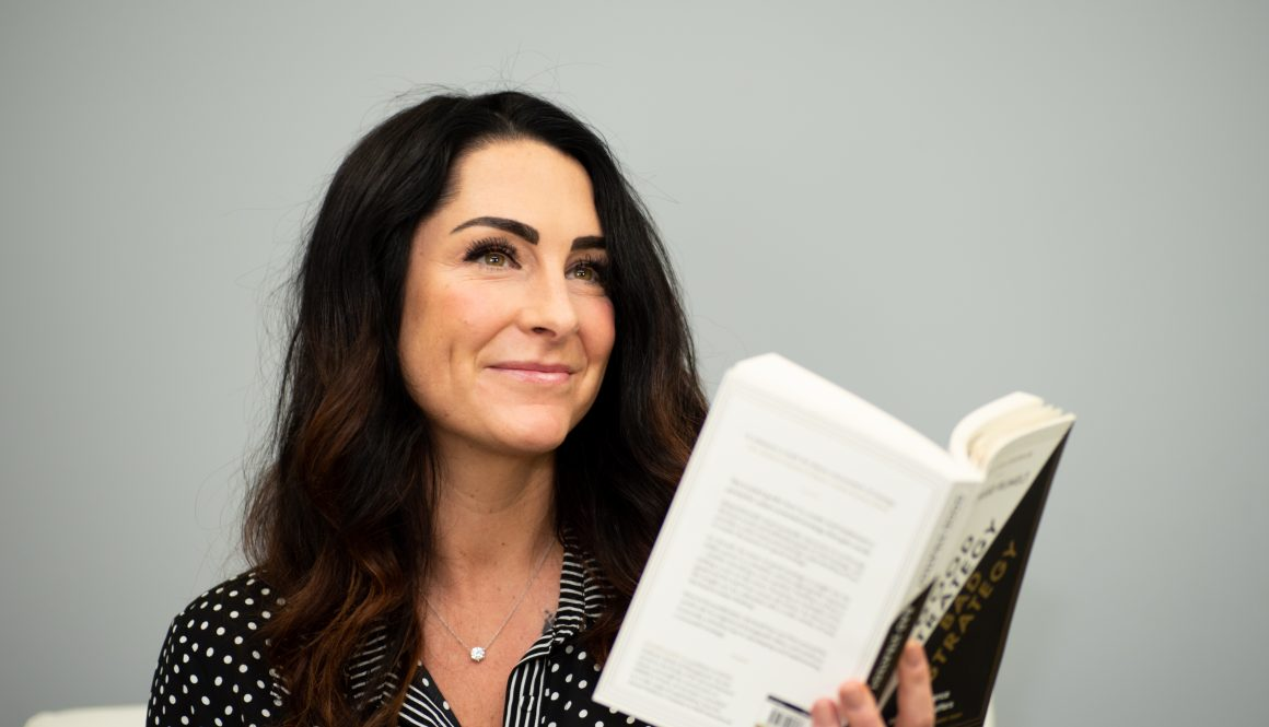 business can be better podcast cohost kelli rae reading a book