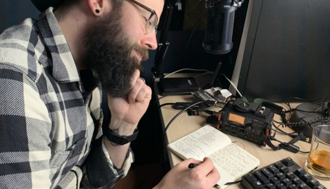 better business podcast host lane writing out his ideas in notebook