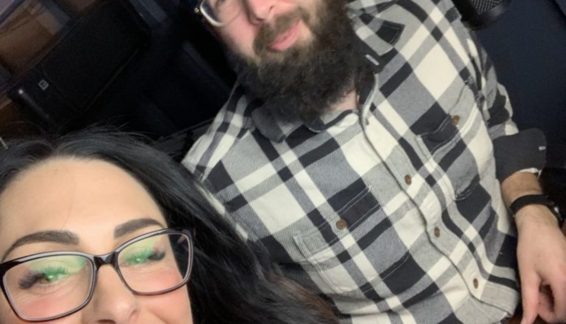 better business podcast hosts kelli rae and lane taking selfie during podcast